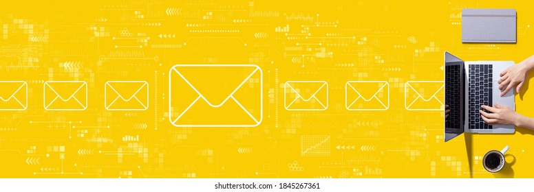 Email concept with person using a laptop computer