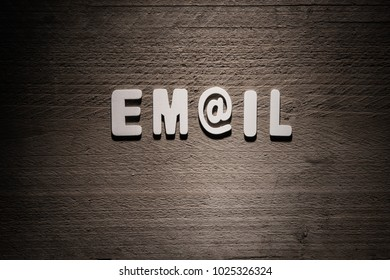 Email concept wood letters on wooden background
