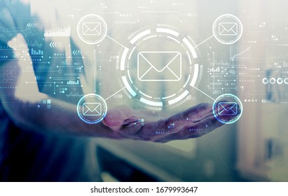 Email concept with young man holding his hand