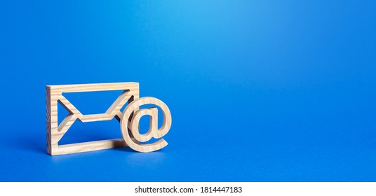 Email figure on blue background. Envelope and AT commercial sign symbol. Concept of email address. Contacts and communication. Business representations on the Internet and social media. Feedback - Shutterstock ID 1814447183