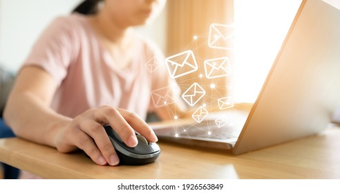 Email marketing concept. Hand using computer sending message with envelope icon