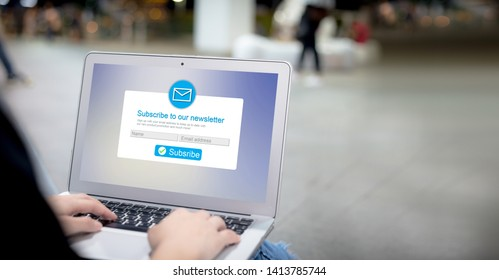 Email marketing subscribe our newsletter concept.Female hands using laptop with copyspace