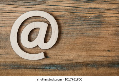 e-mail symbol on wooden background with copy space