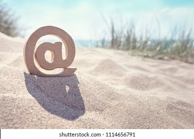 Email symbol in the sand at the beach