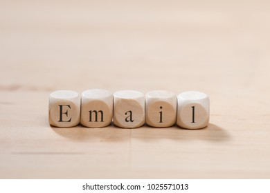 Email word on wooden cubes. Email concept