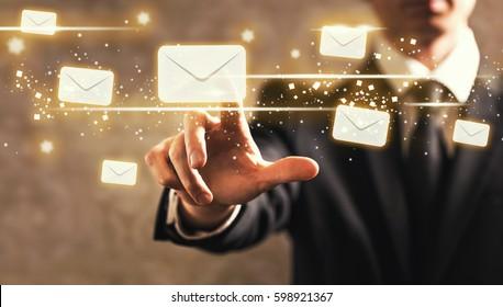Emails with businessman on dark vintage background