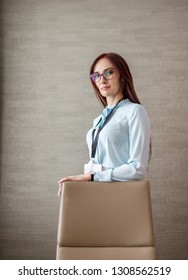 emanding, bitchy Female Business Leader Boss CEO Director posing in her office. business woman wearing spectacles and blank badge at office