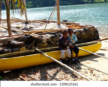 Emao Island / Vanuatu - 13th April 2014: Boys on sitting on a boat before going to church
