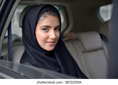 Emarati Arab Business woman in the car in Dubai, United Arab Emirates.