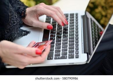 Emarati Arab Business woman making online payment, Dubai, United Arab Emirates.