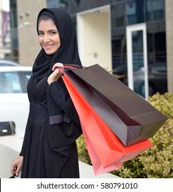 Emarati Arab women coming out of shopping in Dubai, United Arab Emirates.