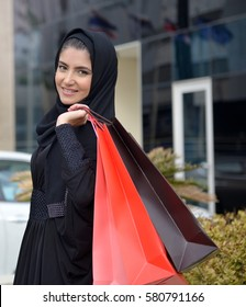 Emarati Arab women coming out of shopping in Dubai, United Arab Emirates.