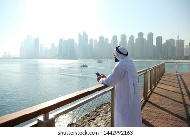 An Emarati local who is successful in business enjoying his life.
