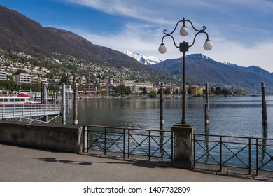 Embankment in Locarno and view of the lake Maggiore and mountains, Ticino, Switzerland