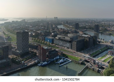 Embankment with modern buildings in the old port area of Rotterdam, The Netherlands seen from above with a sluice-gate and police station with coast guard boats in the foreground
