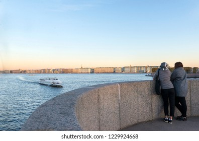 embankment of the Neva river in St. Petersburg, boat on the Neva river, view of the embankment, evening, autumn 2018