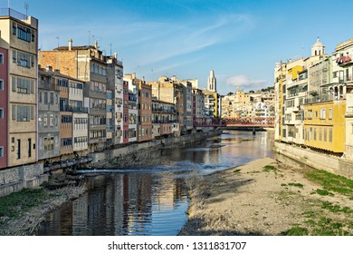 Embankment of Onyar river with colorful houses and bridge. Girona, Catalonia, Spain, Europe.