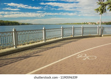 embankment outdoor park waterfront lake shore line district in Ukrainian city Ternopil in bright colorful day time with blue sky
