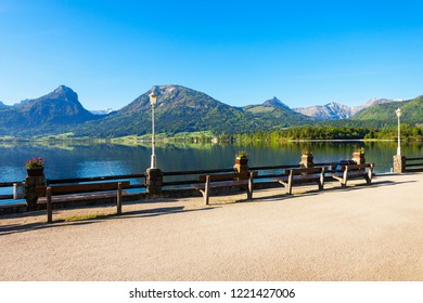 Embankment promenade at the Wolfgangsee lake in Austria. Wolfgangsee is one of the best known lakes in the Salzkammergut resort region of Austria.