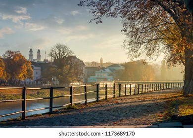 embankment of the river Uzh. beautiful urban scenery with colorful foliage on trees in morning haze. bridge, theater, cathedral towers and other landmarks of Uzhgorod in the distance. Nov 10, 2012