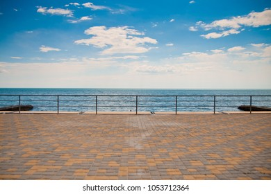 embankment, sea and blue sky