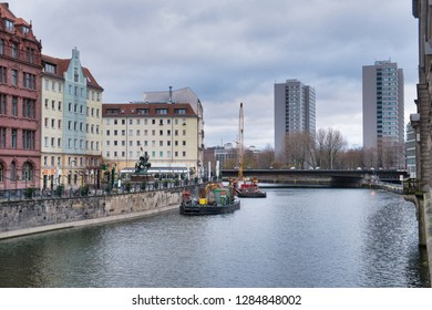 Embankment of the Spree river and the modern sky skyscrappers in Berlin, Germany, at rainy day