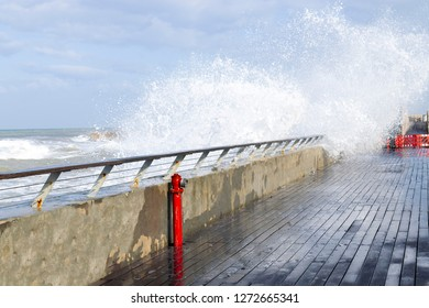 Embankment in Tel Aviv, a wave breaks on the embankment, a beautiful postcard with a sea wave