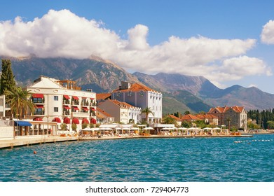 Embankment of Tivat town with mountains in the background on a sunny autumn day. Bay of Kotor (Adriatic Sea), Montenegro