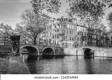 Сanals and embankments of Amsterdam city. Black-white photo.