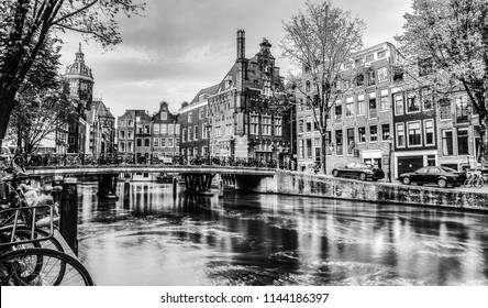 Сanal and embankments of Amsterdam city. Black-white photo.