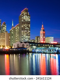 Embarcadero Towers and Ferry Building in San Francisco, illuminated in SF 49ers red and gold colors.