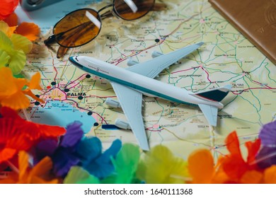 Embark on an adventure. Map, plane, camera, glasses and passport on the table. Travel, vacation concept.