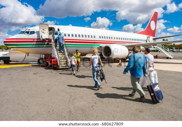 Embarking passengers on the plane. Flight from Nairobi to the city of Mombasa. 02. 01. 2006 Africa. Kenya.