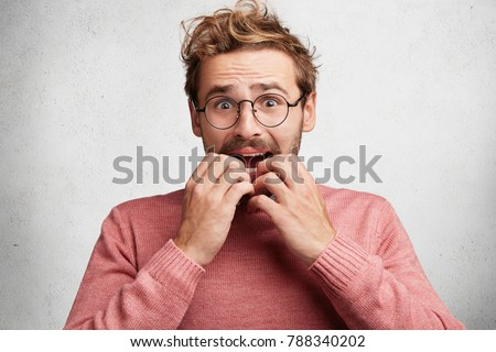 embarrased nervous male looks scared worried stock photo edit now