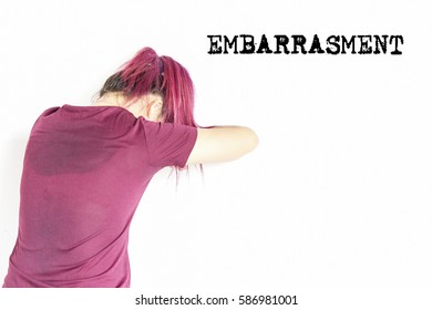 EMBARRASMENT : Typed words impression fo frust, trouble, difficulty, people, emotions, stress and health care concept - unhappy  young woman isolated with white background.