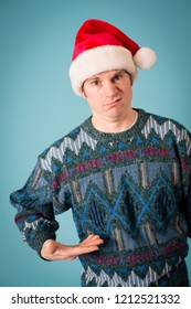 Embarrassed Christmas Guy in Ugly Sweater and Santa Hat