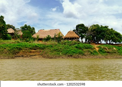 Embera Village, Chagres, Panama - Native tribe huts along Rio Chagres river. The Embera indigenous people still live today as many decades ago in their original homes deep in the Darien.