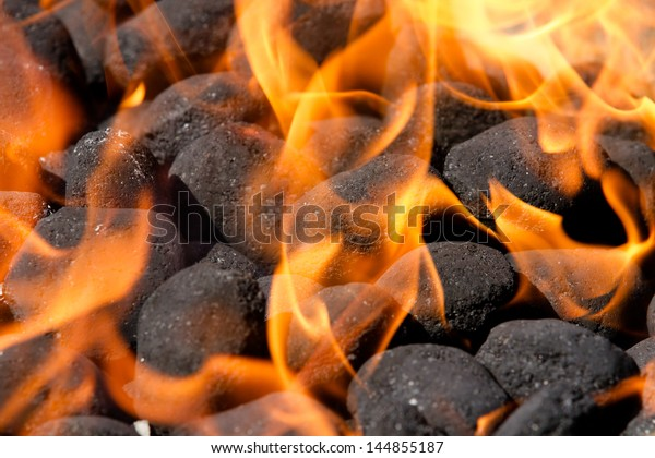embers and blazing fire on a bbq grill