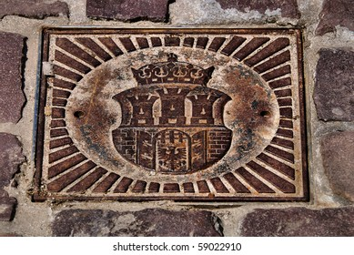 emblem of the city of Krakow on an iron plate