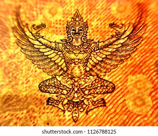 Emblem of Thailand on baht illustration on currency note