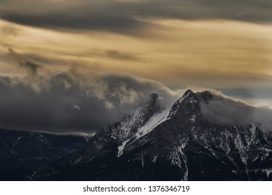 Emblematic mountain of Pedraforca with snow and foog, in the sunset