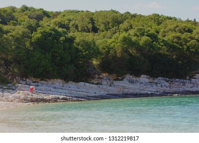 Emblisi, Kefalonia, Greece. Emblisi beach with crystal clear water, surrounded with rocks and forest. Natural beauty of the Kefalonia Island (Ionian Island) in Greece. Amazing Landscape.