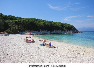 Emblisi, Kefalonia, Greece - June, 3. Emblisi beach with crystal clear water, surrounded with rocks and forest. Natural beauty of the Kefalonia Island (Ionian Island) in Greece. June, 3 2015
