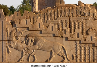 Embossed bas relief carving of a lion hunting a bull on one of the staircases in Persepolis UNESCO World Heritage Site near Shiraz, belonging to Achaemenid Empire, 500 BC.