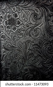 embossed floral pattern in black leather