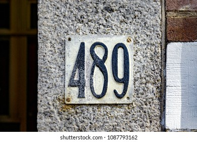 embossed house number four hundred and eighty nine (489).