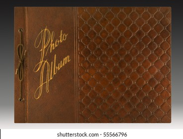 Embossed leather cover of a 1940s-era photo album with gold imprinting. includes clipping path.