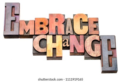embrace change - isolated word abstract in vintage letterpress wood type blocks
