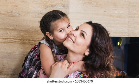 Embrace the child creates the most beautiful feeling of love. Embrace niece. Love between a child and an aunt. Family atmosphere. Family atmosphere as a lifestyle.