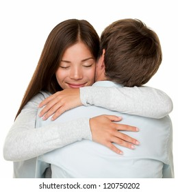 Embracing couple hugging happy. Smiling interracial couple in love isolated on white background.